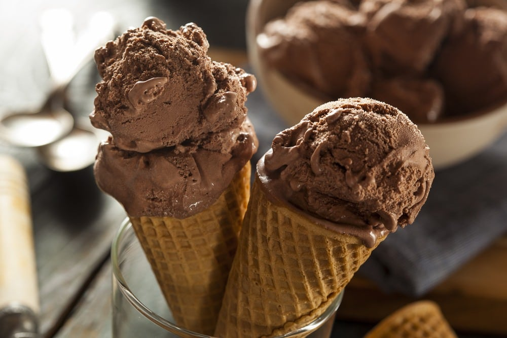 Two chocolate ice cream cones.